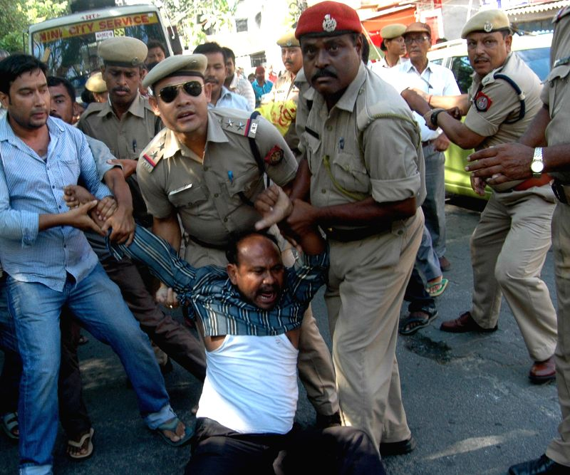 Security personnel trying to stop the activists of Krisak Mukti Sangram Samiti (KMSS) protesting against revenue department's decisions to convert agriculture land to non agricultural land in ...