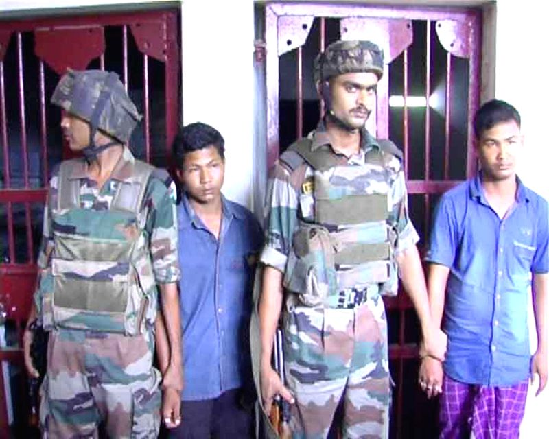 Security personnel with the suspected cadres of National Democratic Front of Boroland (S) who were arrested last night in Kokrajhar district of Assam on June 23, 2014.