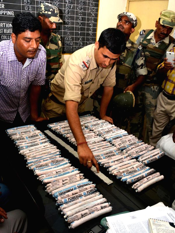 Security personnels display explosives and detonators recovered from Machkhowa bus stand in Guwahati on Sept 4, 2014.