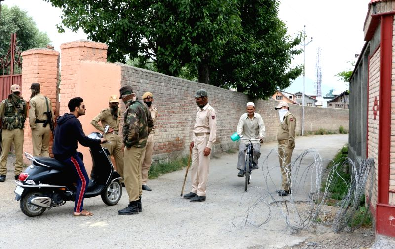 Security stepped up near the residence of senior separatist leader Syed Ali Geelani in Srinagar on June 5, 2017. The Jammu and Kashmir Police disallowed a separatist meeting here scheduled ...