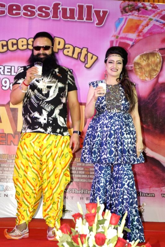 Self styled godman Gurmeet Ram Rahim Singh and Honeypreet Insan during a cow milk party organised to celebrate the success of his film 'Jattu Engineer' in New Delhi on June 7, 2017. Also ...