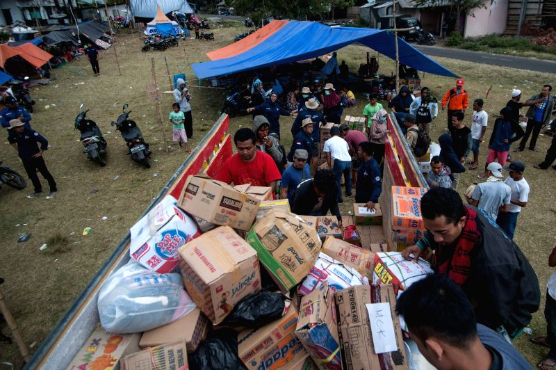 SEMBALUN (INDONESIA), July 31, 2018 Volunteers distribute food and blankets to the refugees in the refugee camp at Sajang village, East Lombok in Indonesia, July 31, 2018. A 6.4-magnitude ...