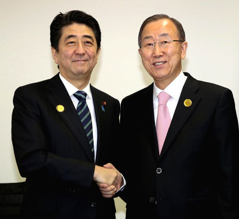 United Nations Secretary-General Ban Ki-Moon (R) shakes hands with Japan's Prime Minister Shinzo Abe during the third United Nations World Conference on Disaster Risk ...