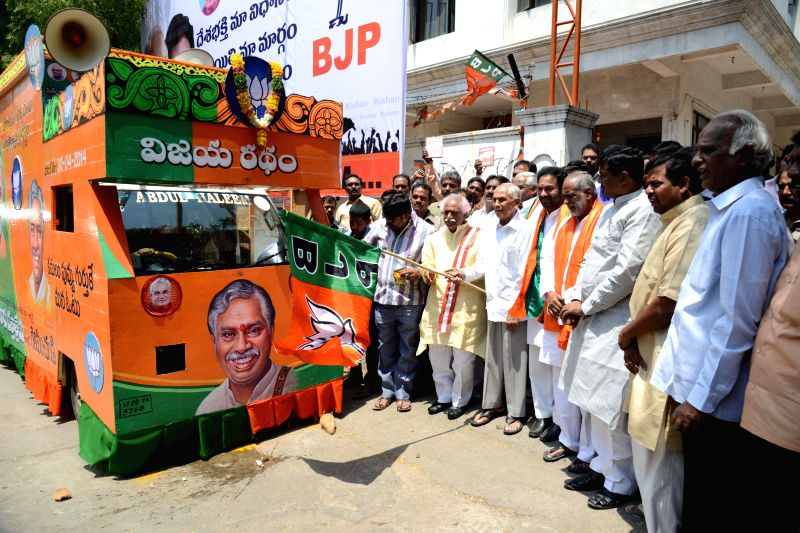 Senior BJP leader Bandaru Datatiriya flags-off party's campaign vehicle for 2014 General Elections in Hyderabad on April 11, 2014.