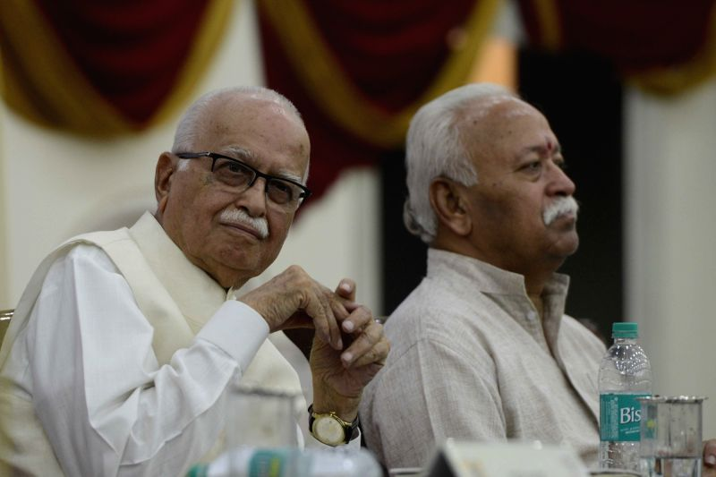 """Senior BJP leader LK Advani and RSS chief Mohan Bhagwat during the book release """"Compassion in the 4 Dharmic Traditions"""" by author Ved Nanda in New Delhi on July 26, 2016."""