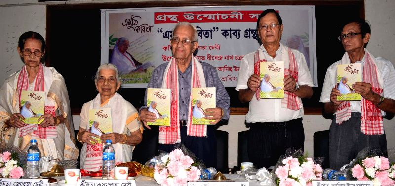 Senior journalist Dhirendra Nath Chakravarty and others launch `Emuthi Kobita` authored by Kusumlata Devi at Guwahati  Press Club on Aug 18, 2014. - Dhirendra Nath Chakravarty