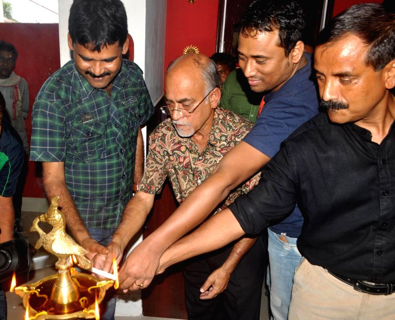 Senior journalist Pranay Bordoloi, Anupam Chakrabarty, artist Noni Borpujari and singer Simanta Sekhar during inauguration of a restaurant 'Adda' in Guwahati on April 10, 2014. - Noni Borpujari