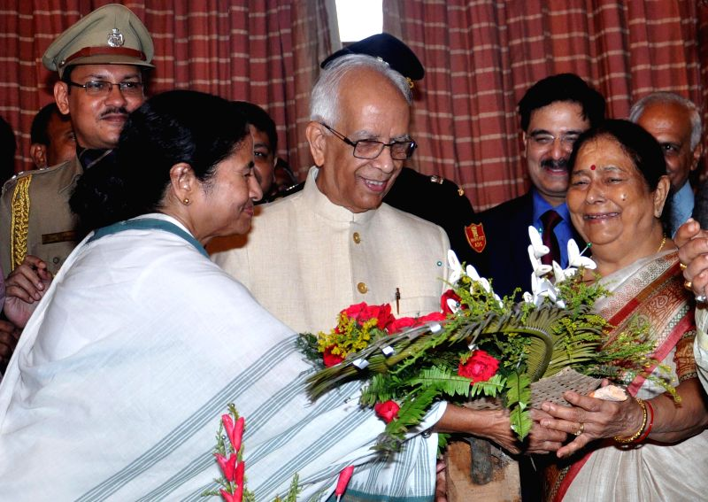 Senior Justice Ashim Banerjee ,West Bengal Chief Minister Mamata Banerjee and New Governor of West Bengal Keshari Nath Tripathi with his wife (L to R) during Governor's oath taking ceremony at Raj ... - Mamata Banerjee and Ashim Banerjee