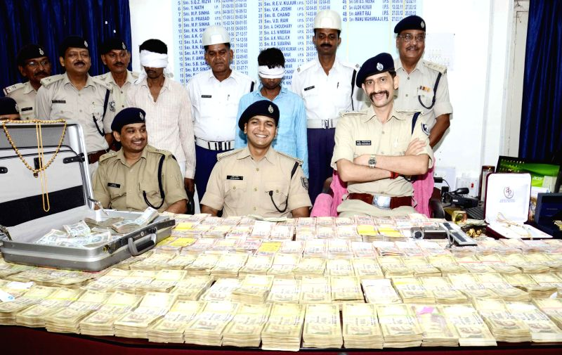Senior Superintendent of Police Manu Maharaj and other police officials during a press conference where they displayed the cash that was allegedly robbed from the residence of BJP leader Giriraj ...