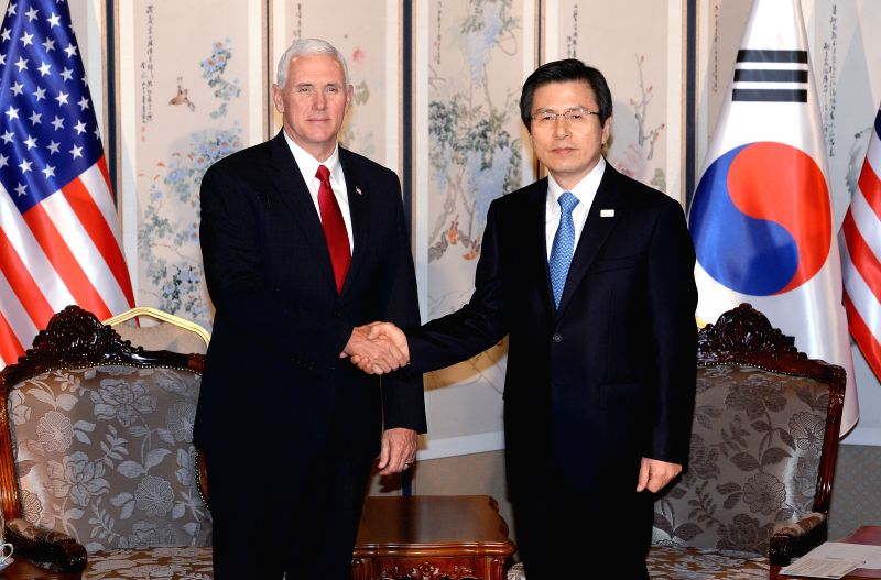 SEOUL, April 18, 2017 - U.S. Vice President Mike Pence (L), shakes hands with South Korean Prime Minister Hwang Kyo-ahn, who is serving as the acting South Korean president, before their meeting in ... - Hwang Kyo