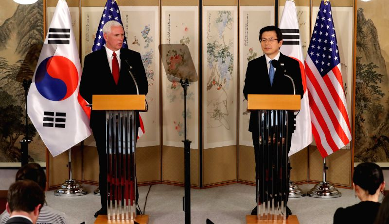 SEOUL, April 18, 2017 - U.S. Vice President Mike Pence (L) and South Korean Prime Minister Hwang Kyo-ahn, who is serving as the acting South Korean president, attend a joint press conference in ... - Hwang Kyo