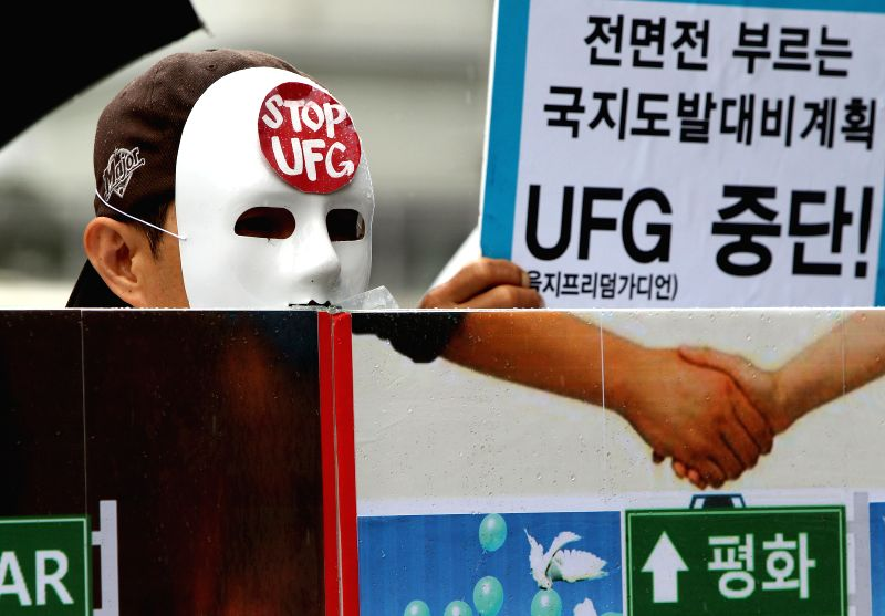 "Protesters attend a demonstration against the joint military exercise ""Ulchi Freedom Guardian"" (UFG) in Seoul, South Korea, Aug. 18, 2014. South Korea and .."