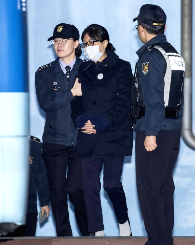SEOUL, Feb. 13, 2018 - Choi Soon-sil (C), a confidante of former South Korean President Park Geun-Hye, leaves the Seoul Central District Court in Seoul, South Korea, Feb. 13, 2018. Choi Soon-sil, a ...