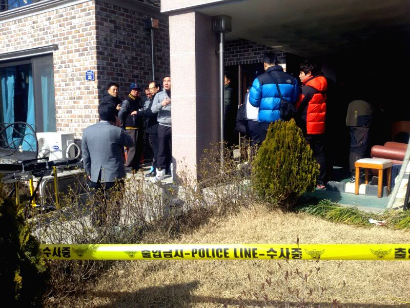 Police search the house where the shooting rampage happened in Hwaseong City,  South Korea, Feb. 27, 2015. Four people were killed and one was injured in a South ...