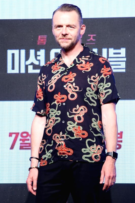 """:Seoul: Hollywood actor Simon Pegg, who stars in the new movie """"Mission: ImpossibleFallout,"""" poses for a photo during a publicity event in Seoul on July 16, 2018. The movie will be released in ..."""