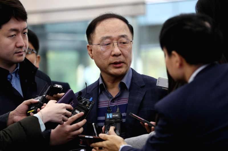 Seoul: Hong Nam-ki, who has been nominated by President Moon Jae-in as the new finance minister, speaks to reporters as he arrives at a temporary office in Seoul on Nov. 12, 2018, to prepare for his parliamentary confirmation hearing.(Yonhap/IANS)