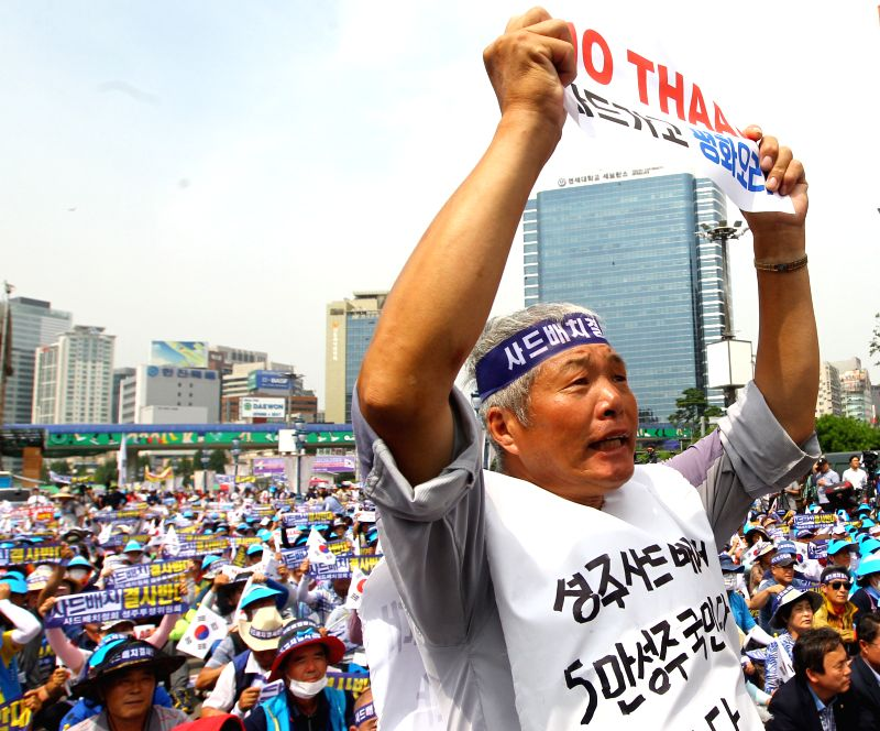 SEOUL, July 21, 2016 - A man from Seongju county holds a banner to protest against the deployment of the Terminal High Altitude Area Defense (THAAD), during a rally in Seoul, capital of South Korea, ...