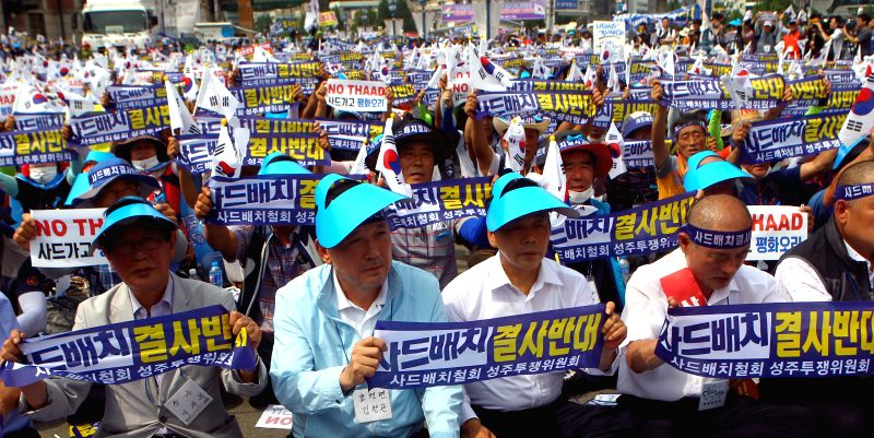 SEOUL, July 21, 2016 - A senior official of Seongju county (2nd L, front) attends a rally to protest against the deployment of the Terminal High Altitude Area Defense (THAAD) in Seoul, capital of ...