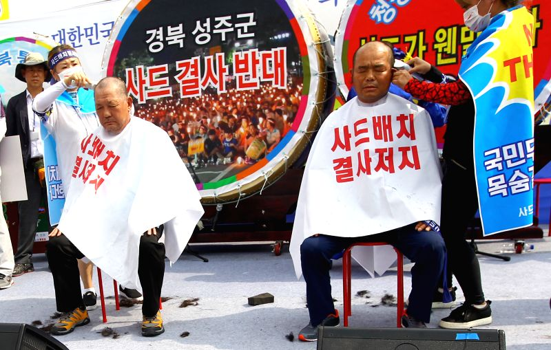 SEOUL, July 21, 2016 - Two officials of Seongju county have haircuts to show their determination to protest against the deployment of the Terminal High Altitude Area Defense (THAAD), during a rally ...