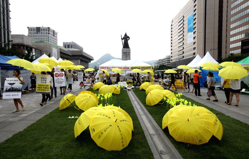 People march to call for the passing of a special bill on April's ferry Sewol disaster in Seoul, South Korea, July 23, 2014. (Xinhua/Park Jin-hee/IANS) ****Authorized