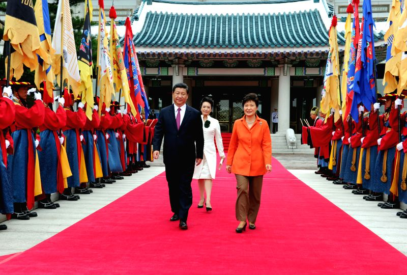 South Korean President Park Geun-hye (front R) holds a welcome ceremony for Chinese President Xi Jinping (front L) at the presidential office Cheong Wa Dae before ...