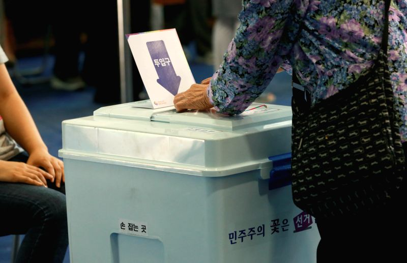 SEOUL, June 13, 2018 - A voter casts her ballot at a polling station in Seoul, South Korea, June 13, 2018. South Korean people began voting early Wednesday in local elections and parliamentary ...