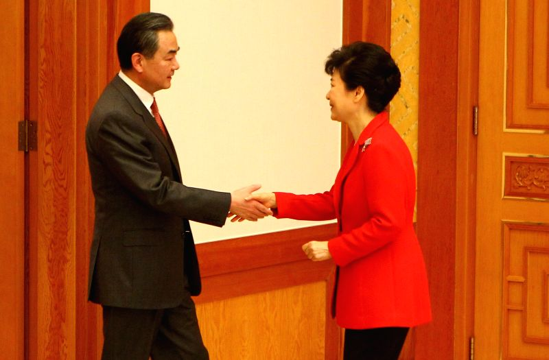 South Korean President Park Geun-hye (R) shakes hands with Chinese Foreign Minister Wang Yi during their meeting in Seoul, South Korea, on March 21, 2015. ...