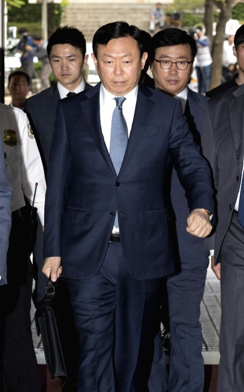SEOUL, May 23, 2017 - Shin Dong-bin (C), chairman of Lotte Group, arrives at the Seoul Central District Court in Seoul, South Korea, on May 23, 2017. Ousted South Korean President Park Geun-hye on ...