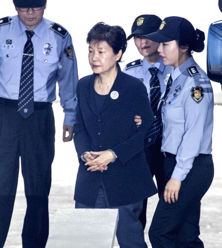 SEOUL, May 23, 2017 - South Korea's former President Park Geun-hye (C) arrives for a trial at the Seoul Central District Court in Seoul, South Korea, on May 23, 2017. (Xinhua/Lee Sang-ho/IANS)
