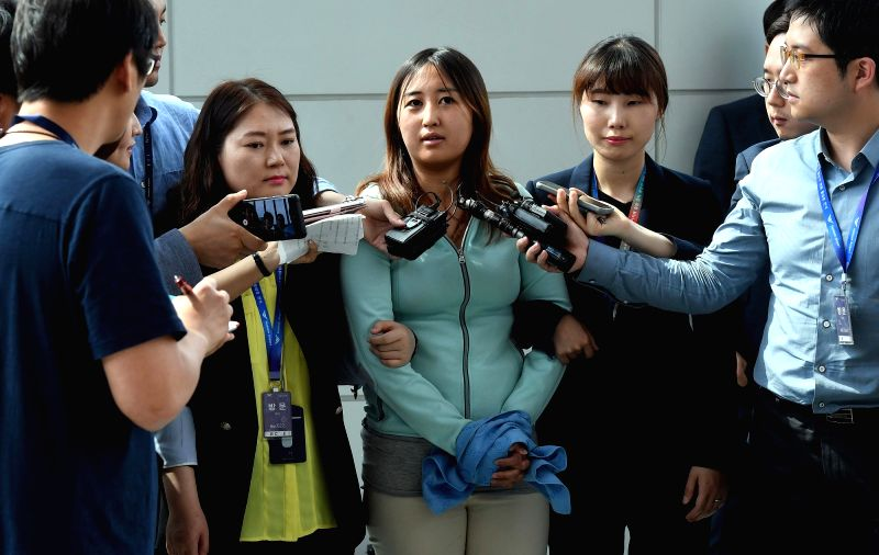 SEOUL, May 31, 2017 - Chung Yoo-ra (C), the daughter of Choi Soon-sil, a longtime confidante of former South Korean President Park Geun-hye, is interviewed upon her arrival at Incheon International ...