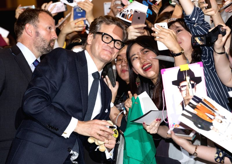 "SEOUL, Sept.20, 2017 - Actor Colin Firth poses for photos with fans during the red carpet event of the movie ""KING'S MAN:THE GOLDEN CIRCLE"" in Seoul, South Korea, Sept. 20, 2017. The film ... - Colin Firth"