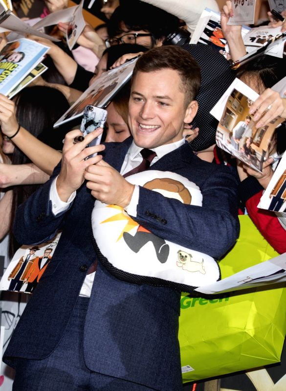 "SEOUL, Sept.20, 2017 - Actor Taron Egerton takes selfies with fans during the red carpet event of the movie ""KING'S MAN:THE GOLDEN CIRCLE"" in Seoul, South Korea, Sept. 20, 2017. The film ... - Taron Egerton"
