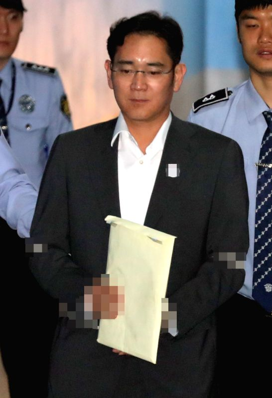 SeoulLee Jae-yong, vice chairman of Samsung Electronics Co., enters the Seoul Central District Court in Seoul on May 11, 2017, to attend a trial for alleged bribery related to the merger of ...
