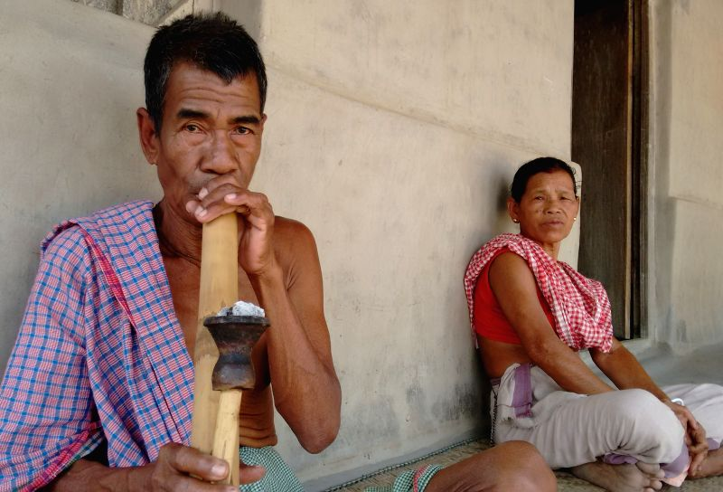 A tribesman smokes traditional hookah in Jampuijala, a remote village in Tripura's Sepahijala district on March 23, 2015.(Image Source: IANS)