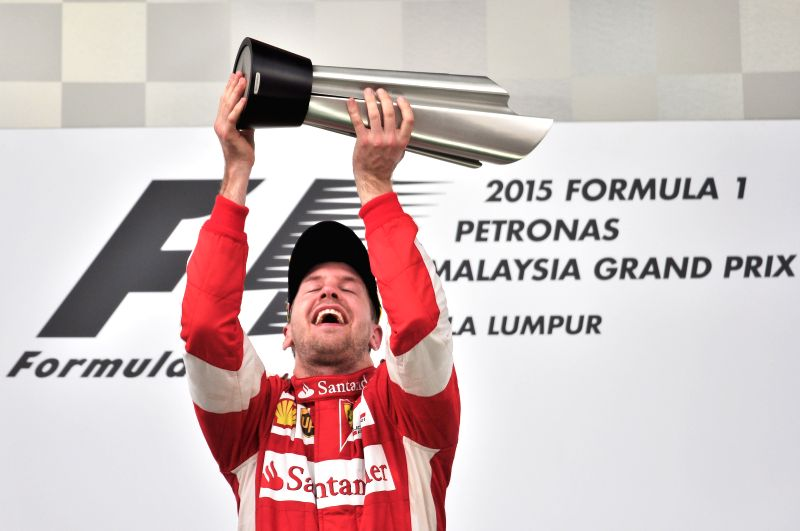 Ferrari driver Sebastian Vettel of Germany celebrates on the podium after winning the Malaysian Formula One Grand Prix in Sepang, Malaysia, March 29, 2015. ...