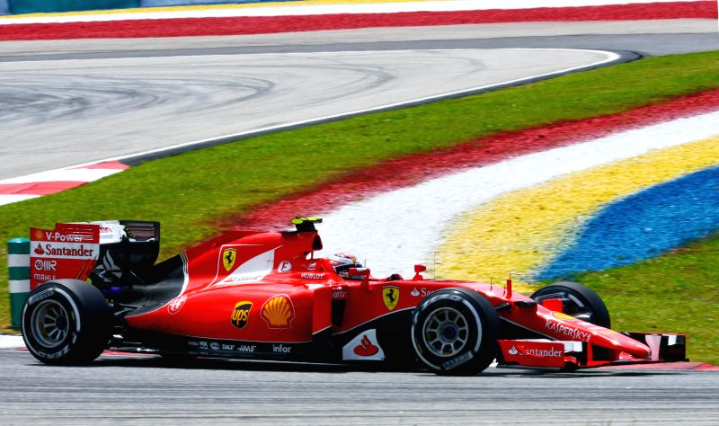 Ferrari driver Sebastian Vettel of Germany competes during the Malaysian Formula One Grand Prix in Sepang, Malaysia, March 29, 2015.