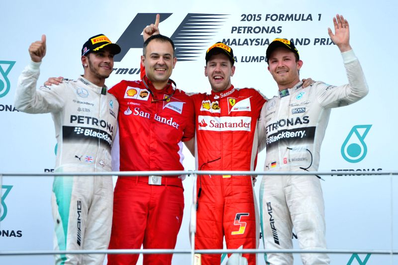Ferrari driver Sebastian Vettel (2nd R) of Germany poses with Mercedes driver Nico Rosberg (1st R) of Germany, Mercedes driver Lewis Hamilton (L) of Britain and ...