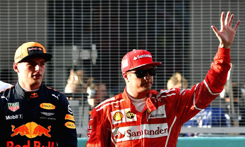 SEPANG, Sept. 30, 2017 - Ferrari's Kimi  Raikkonen (R) of Finland waves to spectators after the qualifying session at the Formula One Malaysia Grand Prix at the Sepang Circuit in Malaysia, on Sept. ...