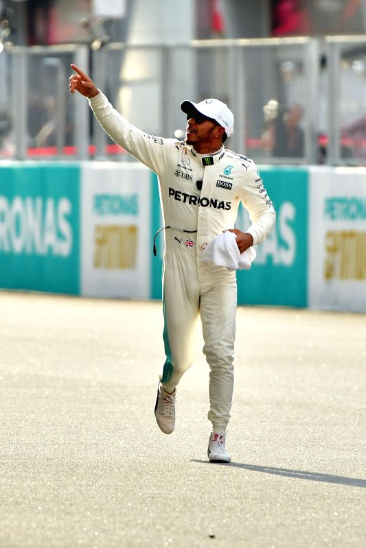 SEPANG, Sept. 30, 2017 - Mercedes' British driver Lewis Hamilton gestures to spectators after winning the pole position in the qualifying session at the Formula One Malaysia Grand Prix at the Sepang ...