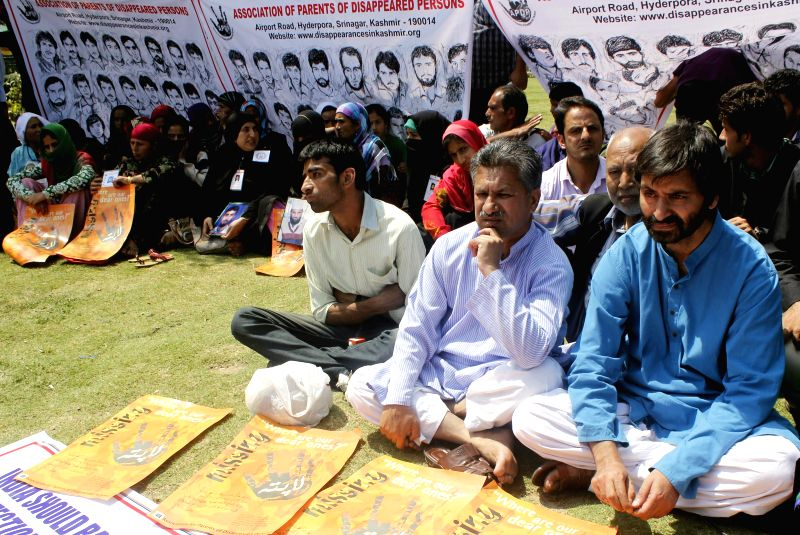 Separatist leader and chairman of Jammu and Kashmir Liberation Front (JKLF), Muhammad Yasin Malik sit on a silent protest with the parents and family members of disappeared persons in Srinagar on ...