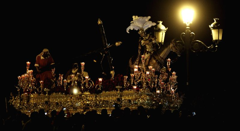Thousands attend the procession of the Cristo de las Tres Caidas (Christ of the Three Falls) at the start of its procession in Seville, Spain, early 03 April 2015, night in which up to six ...