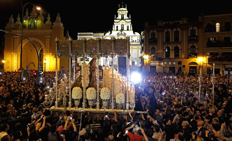 Thousands attend the religious procession of the Macarena at its Basilic in Seville, Spain, early 03 April 2015, night in which up to six lay brotherhoods held different processions in the ...