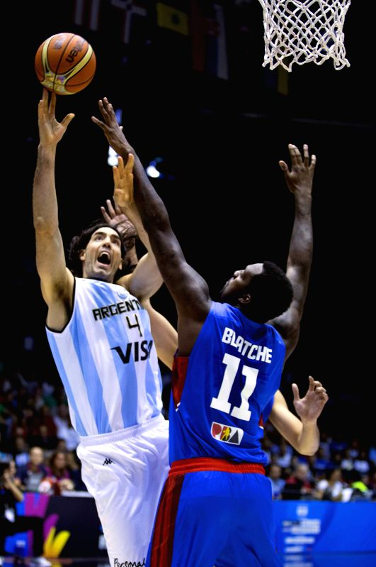 Argentina's Luis Scola (L) tries to score in front of Andrey Blatche of the Philippines during their Group B match at the 2014 FIBA Basketball World Cup Spain, in ..