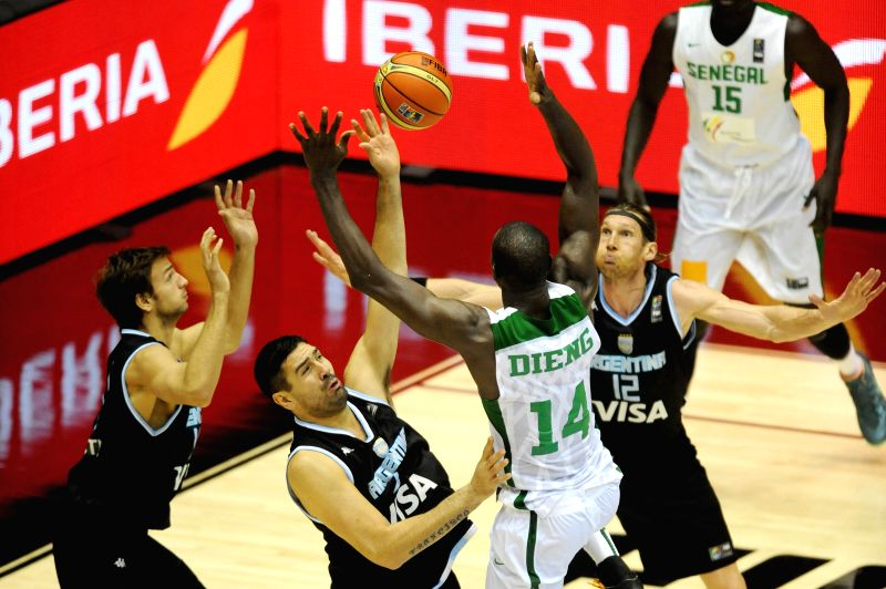 Gorgui Dieng (2nd R) of Senegal vies for the ball during the group B match against Argentina at the 2014 FIBA Basketball World Cup, in Seville, Spain, on Sept. 3, ..