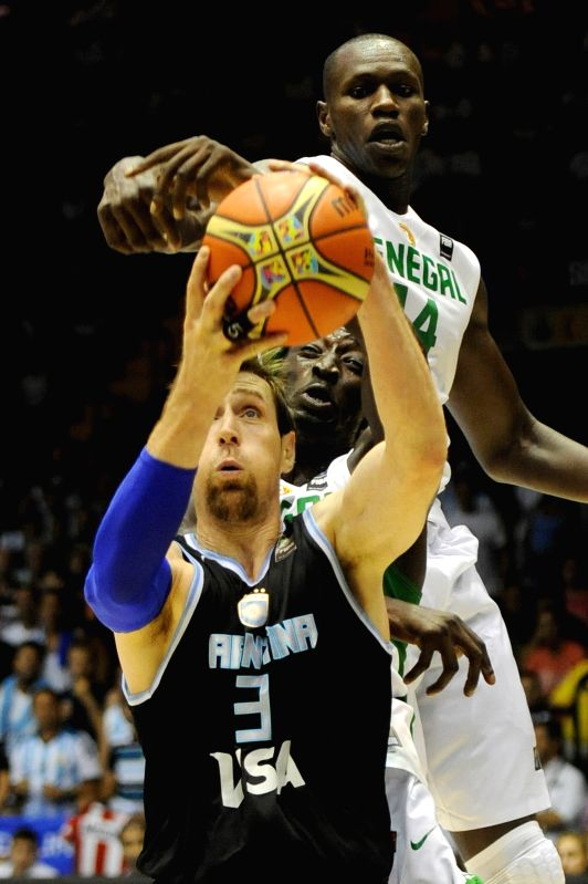 Gorgui Dieng (above) of Senegal vies for the ball with Argentina's Andres Nocioni during their group B match at the 2014 FIBA Basketball World Cup, in Seville, ...
