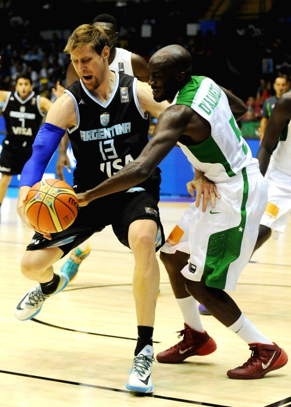 Xane D'Almeida (R) of Senegal vies for the ball with Argentina's Andres Nocioni during their group B match at the 2014 FIBA Basketball World Cup, in Seville, Spain,
