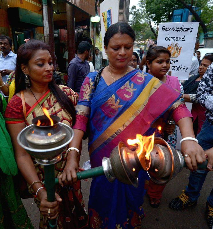 Sex workers participate in a rally organised on International Workers' Day organised by Durbar Mahila Samanwaya Committee in Kolkata, on May 1, 2017.