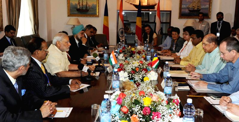 Prime Minister Narendra Modi and the President of Seychelles James Michel during delegation level talks, in Seychelles on March 11, 2015. Also seen Foreign Secretary S Jaishankar. - Narendra Modi
