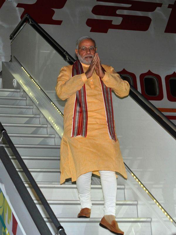 Prime Minister Narendra Modi arrives at Seychelles International Airport on March 10, 2015. - Narendra Modi