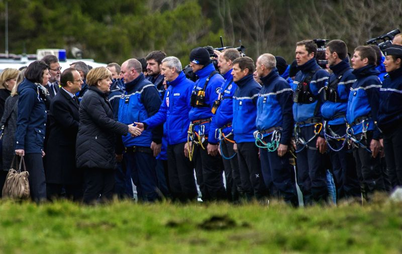 SEYNE-LES-French President Francois Hollande(2nd R, front) and German Chancellor Angela Merkel(1st R, front) shake hands with rescue team members in Seyne-les-Alpes, ... - Mariano Rajoy